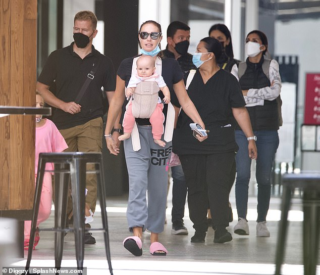 Family: Daughter Serena was strapped to her chest in a baby sling as she held Sophie's hand as they strolled through the mall