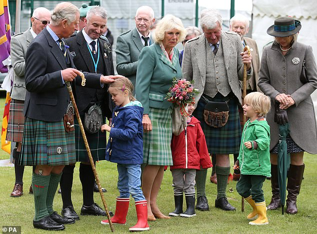 Duke and Duchess of Rothesay are greeted by the Duchess's grandchildren as they attend the Ballater Highland Games