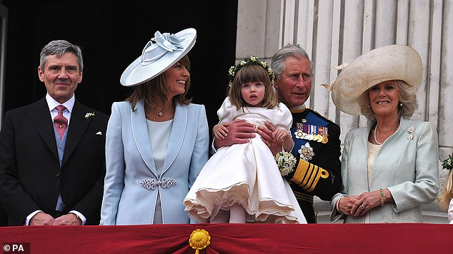 Left to right: Michael Middleton, Carole Middleton, Prince Charles, holding bridesmaid Eliza Lopes and the Duchess of Cornwall, on the balcony of Buckingham Palace, London, following the wedding of Prince William and Kate Middleton