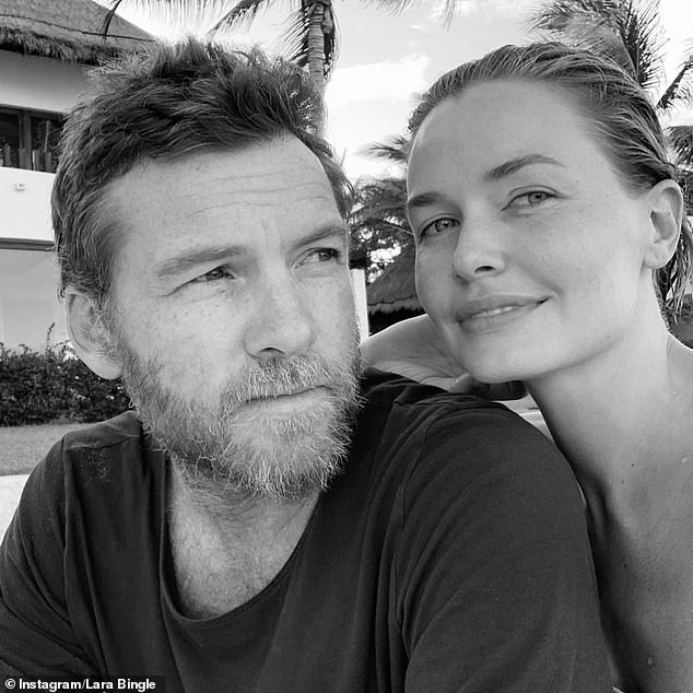Strict diet: Model Lara Worthington, 33, spoke to Sunday Life about her family's strict vegetarian diet this weekend, revealing that her three sons have never tasted meat before. Pictured here with actor husband, Sam Worthington