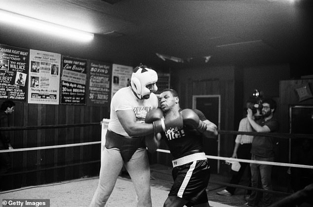 Lewis remembers his first brush with Tyson when a young Iron Mike tried to kill him in sparring