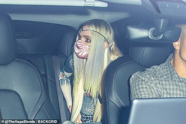 Date: Grimes was seen climbing into the back of a car after partying in New York City until 6 a.m.