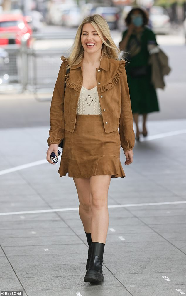 Yee-haw: Mollie King looked sleeker than ever when she arrived at BBC Radio One studios in a brown suede cowgirl jumpsuit on Sunday
