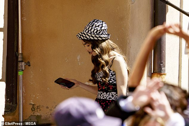 Get the message: Lily appeared to check her phone while filming the second season of the hit show