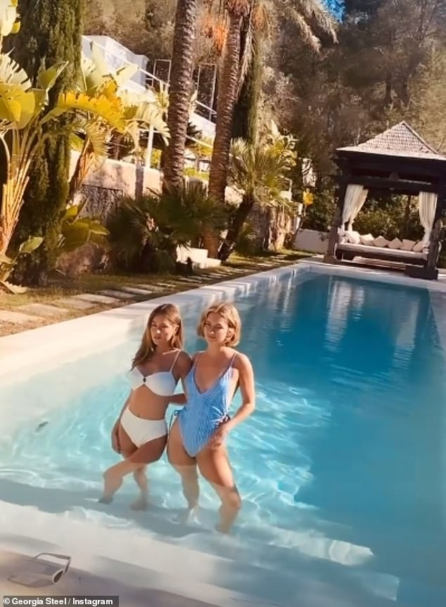 Team work:Stepping into the pool with another model, Georgia donned a chic white two-piece bikini, and wrapped arm around her companion's back