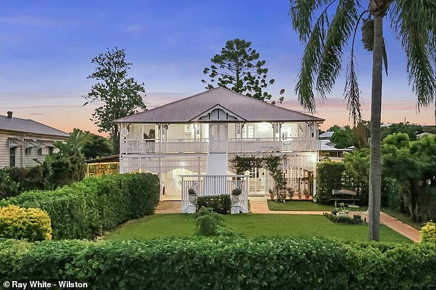 Going, going, gone: Triple M Brisbane radio host and former rugby union fullback Greg 'Marto' Martin has sold his home of 24 years at auction for $3.17million