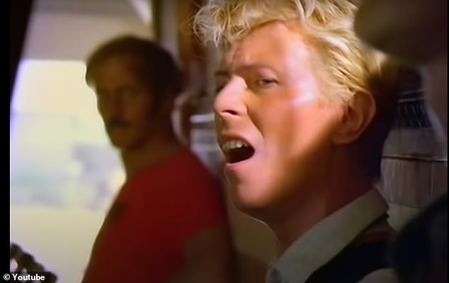 Mr Griffin can be seen leaning against the wall behind Bowie during the video