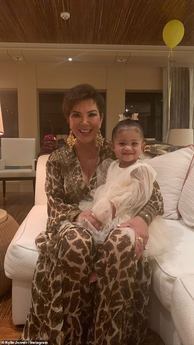 Sweet: Paying homage to her own mom, the reality star posted a cute picture of Kris Jenner holding Stormi on her lap as they smiled at the camera and sat on a cozy couch