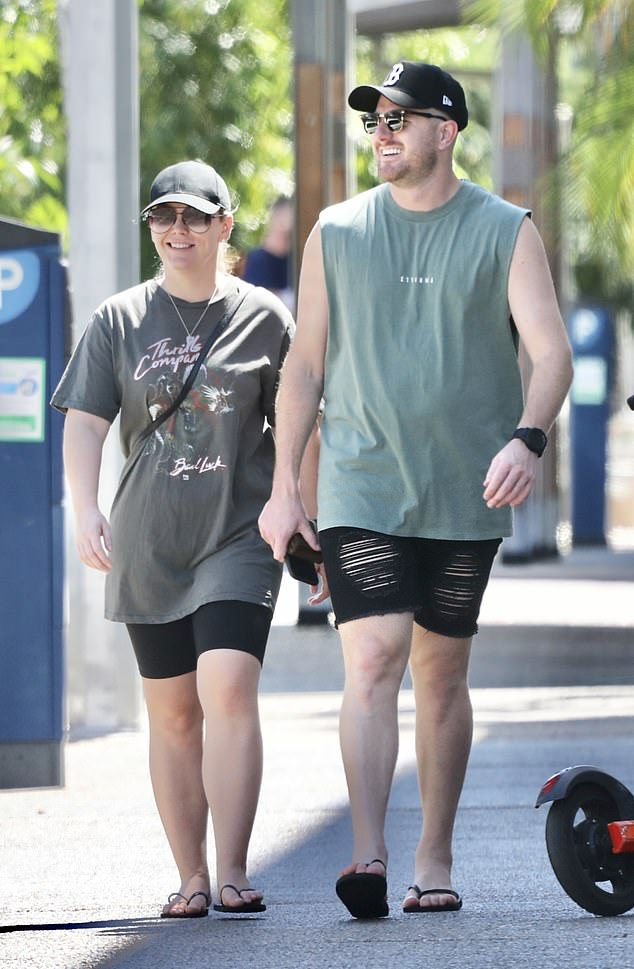 Two peas in a pod! Married At First Sight's Bryce Ruthven, 31, (left) and 'wife' Melissa Rawson, 31, (right) showcased their unbreakable bond on Saturday by stepping out together in Darwin wearing matching outfits