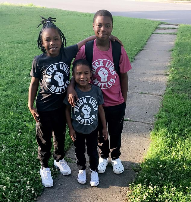 Two Oklahoma boys, Bentlee (left) and Rodney (center), were removed from class for wearing Black Lives Matter t-shirts after their mother was told politics is banned from schools since the George Floyd case. Their brother Jaleon (right) was not removed on account of his t-shirt