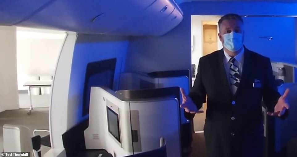 Turning left: Mr Whipp in the mock BA first-class cabin. He explained that crews are regularly assessed and tested by the airline at its training academy and before every flight
