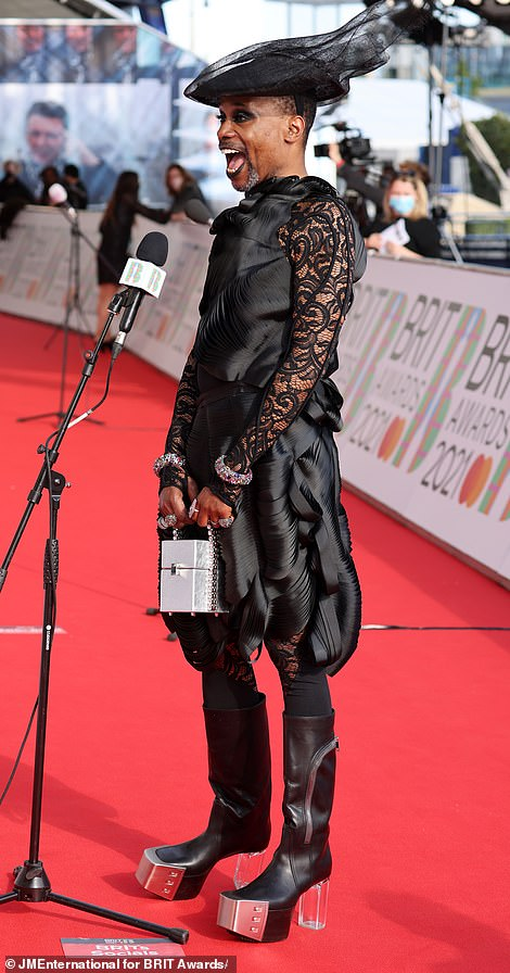 In his bag: The screen star complemented his metallic boots with an embellished silver bag