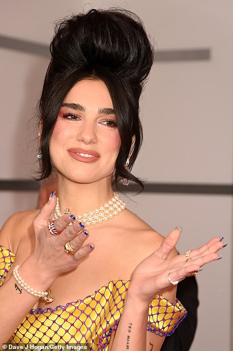 Respects:Dua, pictured, appeared to pay homage to late singer Amy Winehouse, who tragically passed away aged 27 on the 23 July in 2011, with her hair styled in a similar beehive hairdo