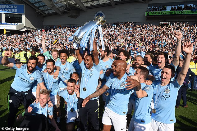 The midfielder (with trophy) has been key to helping City win the title three times in four years