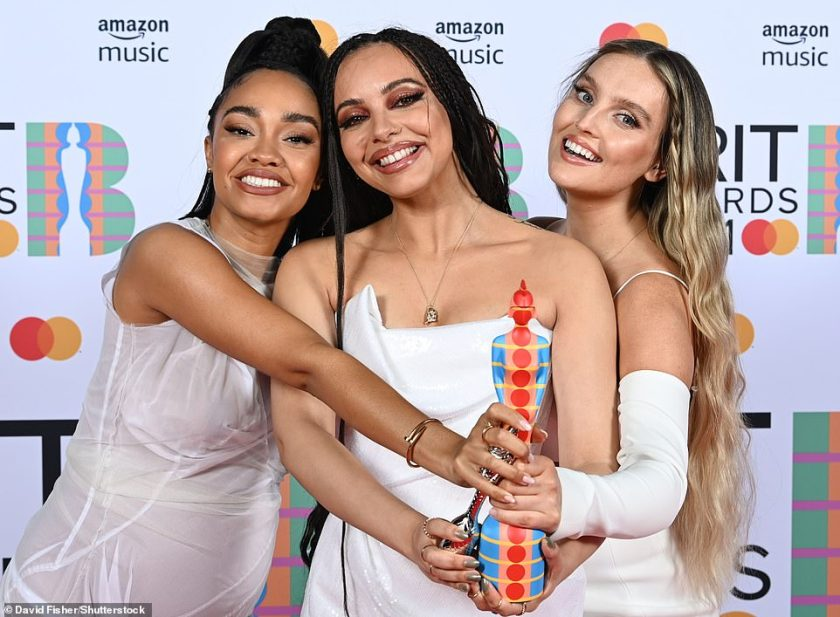 Well deserved: Leigh-Anne, Jade and Perrie ensured to thank their devoted fans and ex-bandmate Jesy Nelson for 'the best years of our life' as they excitedly accepted the award