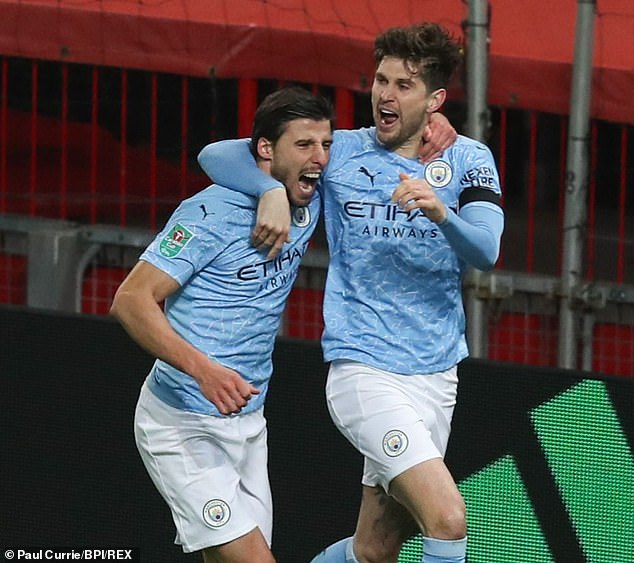 Ferdinand has called on United to build a defence as fearful as Manchester City's centre-back partnership of Ruben Dias (left) and John Stones