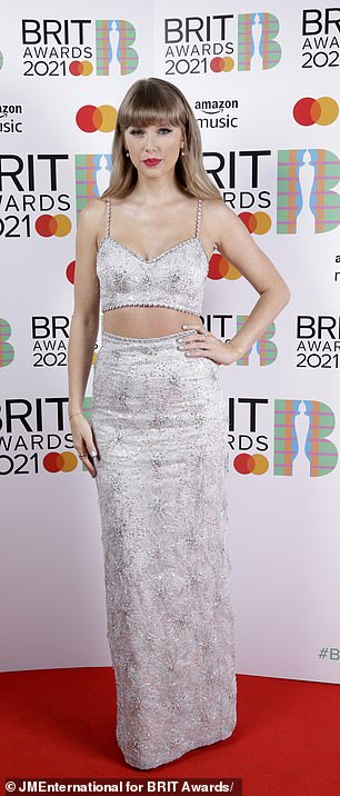 Passion for fashion: Taylor donned a Miu Miu crop top and skirt made of white organza