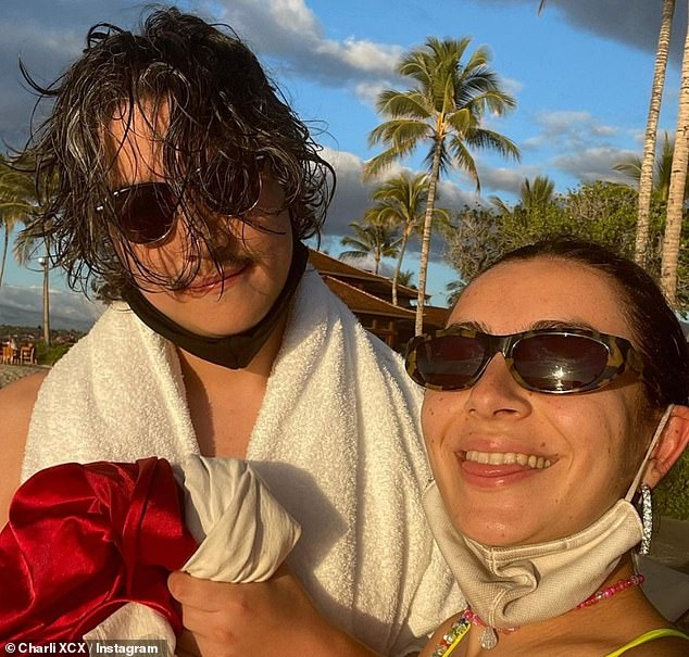 Happy couple: With her brunette hair swept into a ponytail and her face makeup-free, Charli flashed her social media followers a smile as she lapped up the sunshine