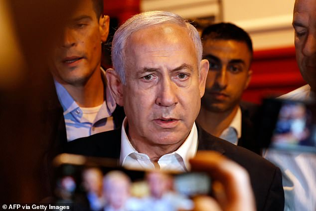 Benjamin Netanyahu (pictured in Lod) has declared a state of emergency in the central city as police accused Arab residents of waging 'wide-scale riots'