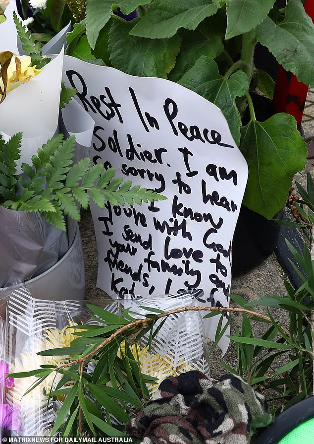 Pictured: A handwritten note left for Spencer at the scene of the tragedy