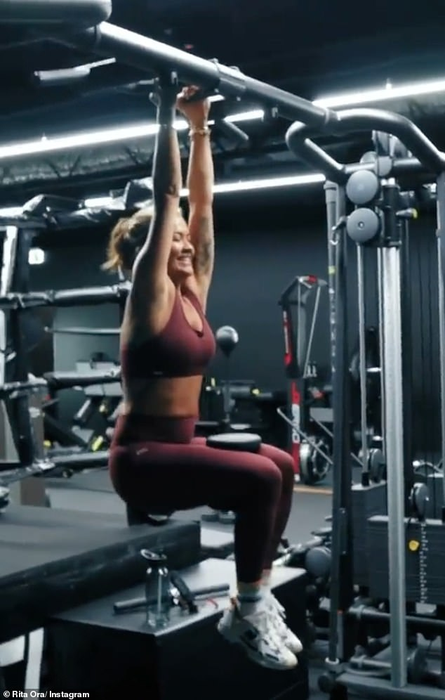 Working up a sweat! Rita Ora (pictured) showed off her incredibly toned figure in a crop top and tights as she completed an intense workout at Acero gym in Sydney on Wednesday
