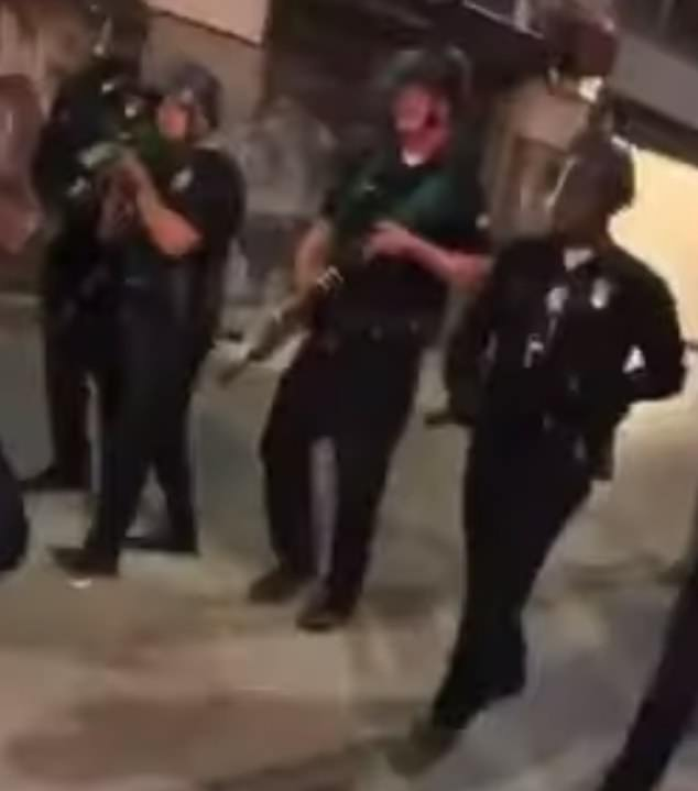 Video shows Shakir approaching his uncle, Eric Anderson (right), on the night of the protest