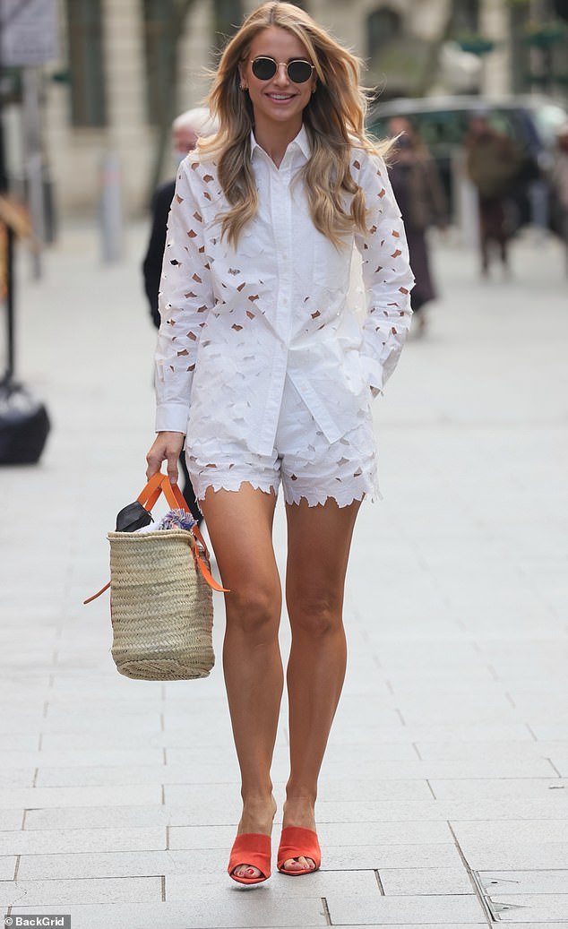 Vision in white:Vogue Williams nailed spring fashion on Wednesday as she put on a leggy display in a broderie anglaise two-piece for her Heart FM show
