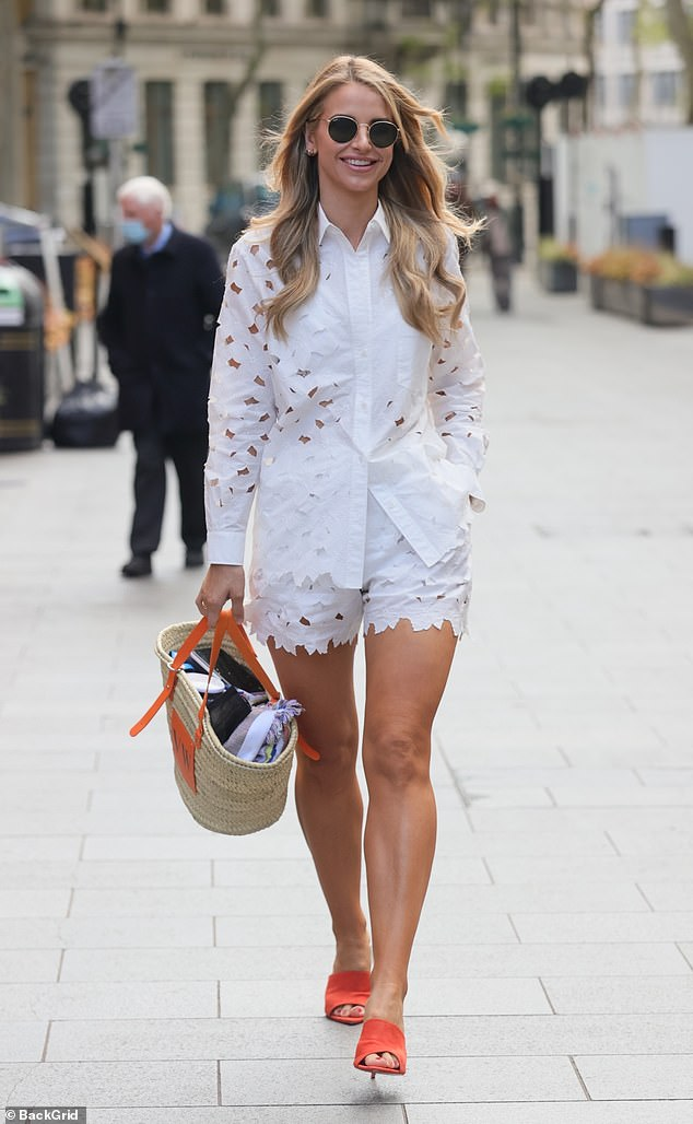 Toned figure:The radio host, 35, looked radiant in her cutwork shirt and matching shorts as she strutted inside the Global Radio Studios building in London