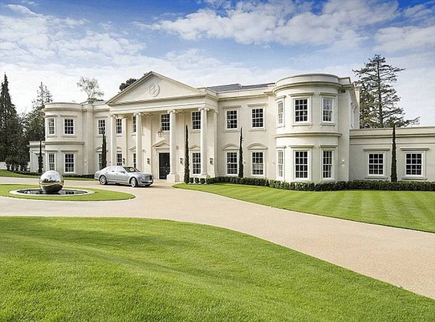The mansion in Surrey boasts its own pool, spa, wine cellar and cinema and underground car park with space for ten cars