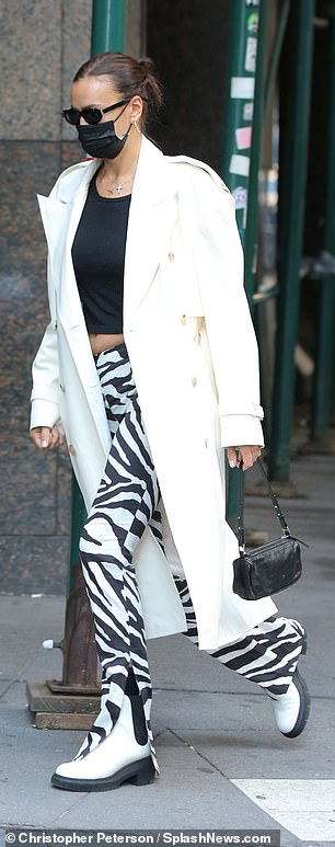 One day prior, Irina sported zebra trousers, adding a black top and a white coat with two tone boots