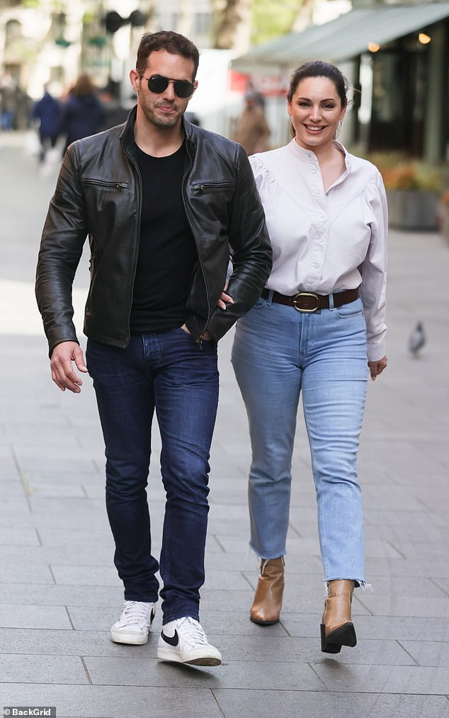 Going strong: The couple - who have been dating for six years - packed on the PDA as they stopoed for a smooch while out in the capital