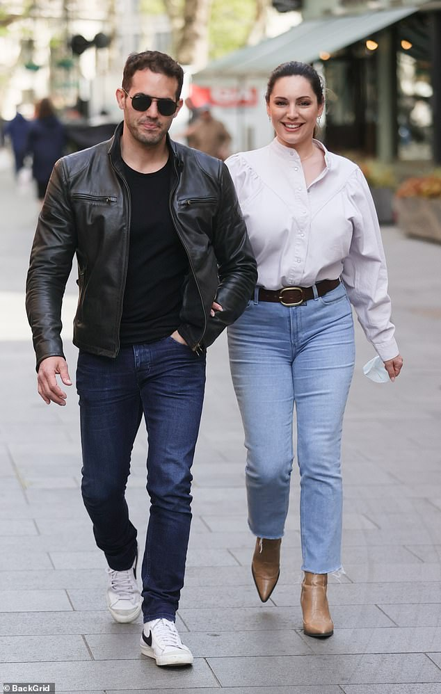 Low-key: Kelly donned a crisp white shirt tucked onto stone-wash jeans, finished off with a brown belt. She added tan ankle boots to the look and wore her chestnut mane tied back from her stunning features