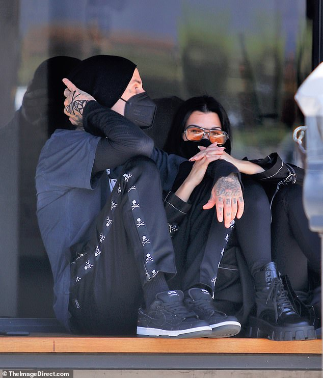 Safety first:Both Kourtney and Travis wore black face masks to protect themselves and others against COVID-19