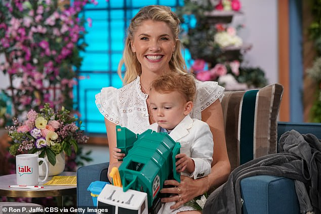 Widow: The Talk co-host Amanda Kloots (pictured last Friday) teared up over the pressures of being a working single mother during Wednesday's episode of the CBS talk show