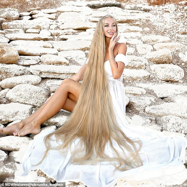 Her hair is longer than her five-feet-six-inch tall frame and means she sometimes steps on her hair when it is hanging loose