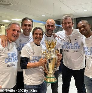 Guardiola and his coaching team, alongside Fernandinho (right), with a replica Premier League trophy