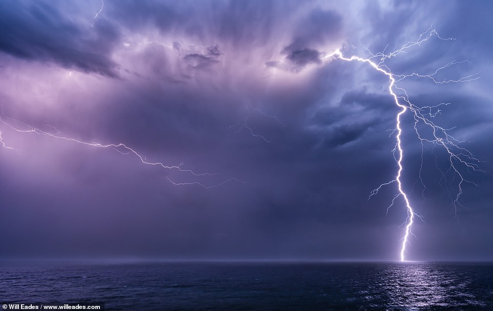 An 'epic clear air bolt touching down in the Pacific', is Will's description of this stunning image, taken just after sunset off the coast of Port Macquarie. He adds: 'When this massive one dropped it scared the hell out of my mate, which makes me like it even more'