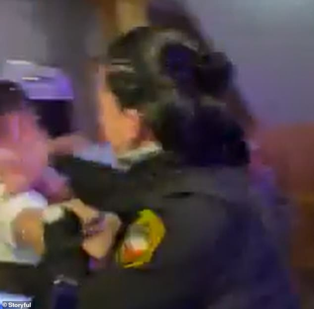 The security guard could be seen punching a man in the face multiple times