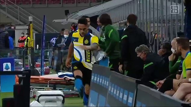 Inter Milan striker Martinez kicks out at a water bottle (seen as a motion blur to the right of striker) after being substituted during his side's 3-1 victory over Roma