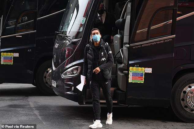 Brazilian striker Roberto Firmino gets off the team coach before the game on Thursday