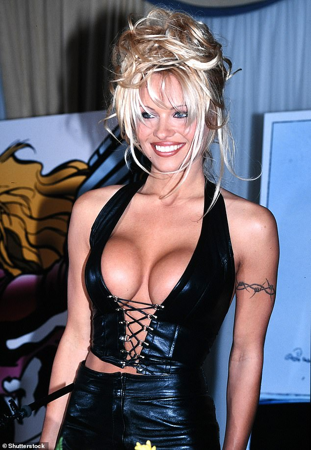 Busty: Pamela is said to have had two breast implant surgeries in the early 1990s, increasing her breast size to a 34D, then to a 34DD respectively (Photo; 1995)