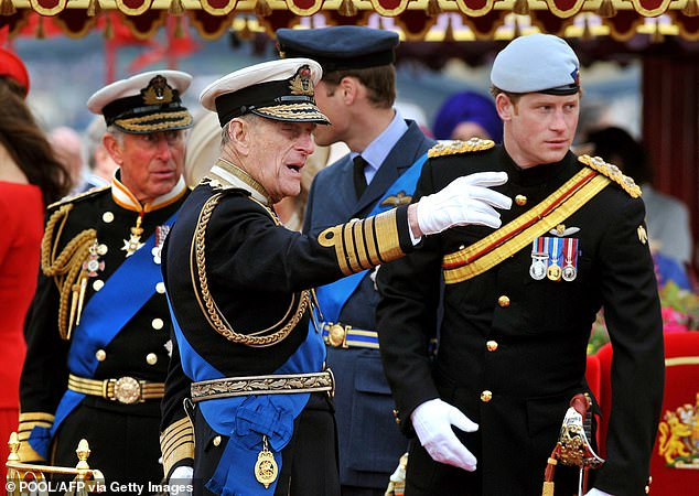 Before the family rift: Prince Charles, Prince Philip and Prince Harry are pictured during the Thames Diamond Jubilee Pageant in London on June 3, 2012