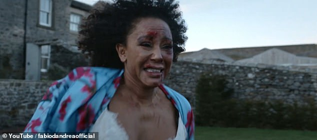 Hard-hitting:Mel B, 45, has appeared beaten and covered in bruises for a shocking music video to highlight the effects of domestic violence