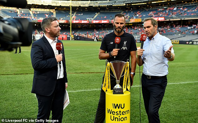 Berger (centre) being interviewed ahead of a Liverpool pre-season game in 2019