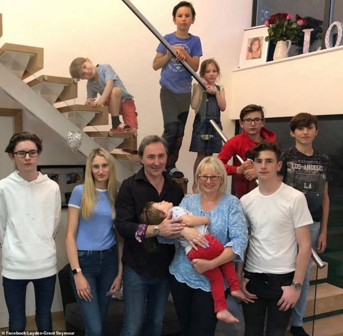 The couple, pictured with their children at their Suffolk home, are now spending a 'phenomenal amount of money' on their family and Layden is determined to ensure her family's future financial security.