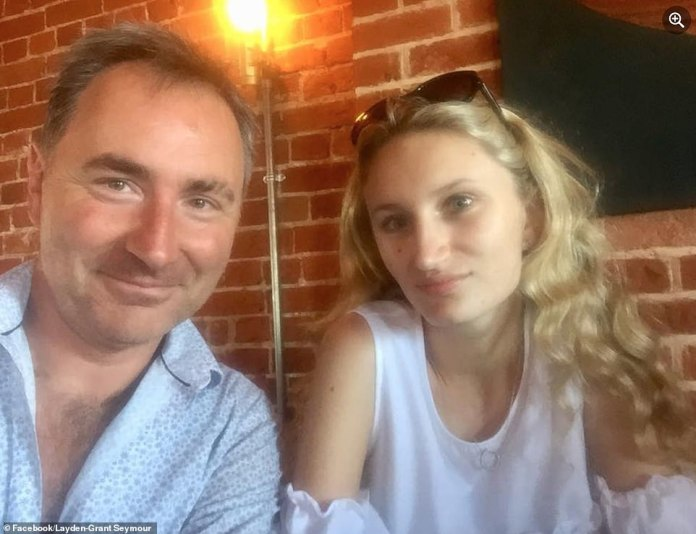 The father is pictured with his eldest daughter Taylor, 21, who sometimes helps the couple care for their eight siblings