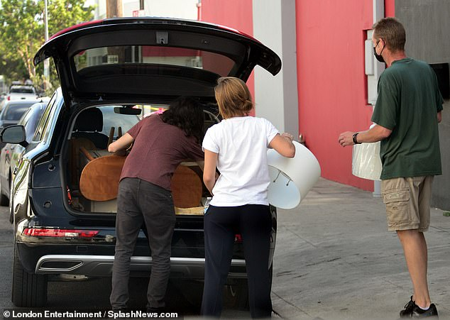 Helping hand: Emma needed some assistance from the furniture staff who helpfully walked the items out to her car