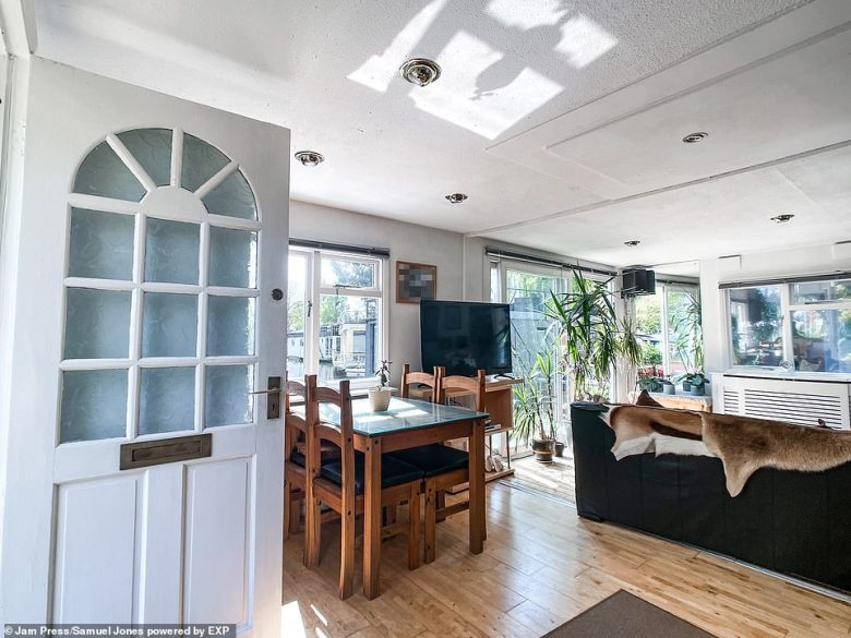 The kitchen and dining area, with patio doors leading outside. The estate agents said in the property's description:'Kingston-upon-Thames, great for shopping and evening entertainment is a further 10 minute drive or short bus ride, with bus stops both ways near the island bridge'