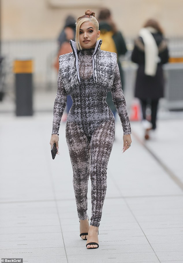 Stylish: She let the outfit speak for itself and kept accessories to a minimum, wearing just a handful of subtle silver rings on her right hand
