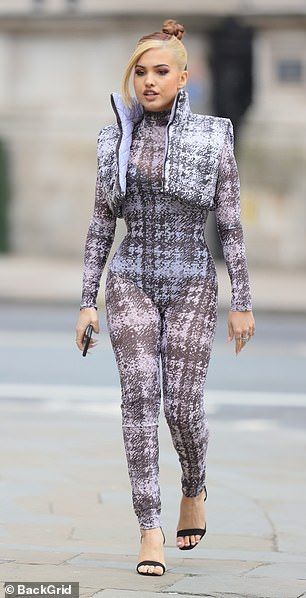 Hard at work: The Don't Call Me Up star flaunted her enviable figure in the asset accentuating outfit on her way to rehearsals ahead of the Radio 1 Big Weekend